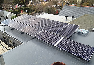 Solar panels: Charcoal colour Panasonic PV system as an in-house system with slate roof tiles